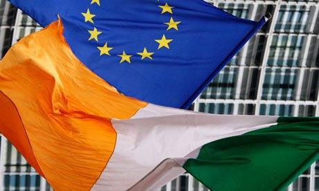An Irish flag flies next to an EU flag in Brussels